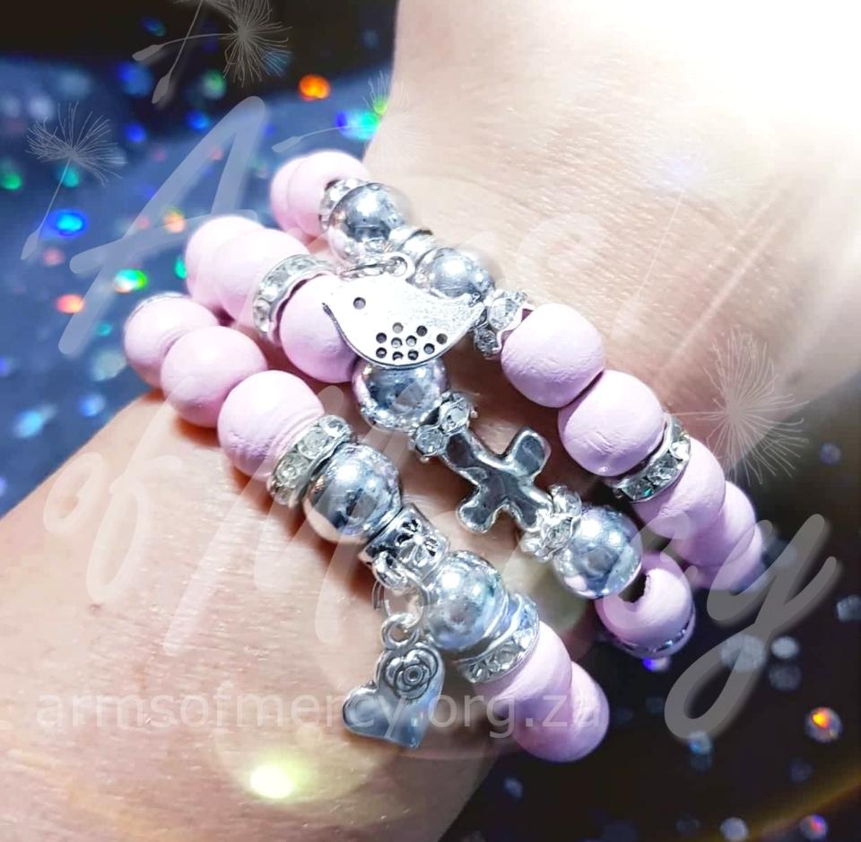 Cute in Pink Bracelets © Arms of Mercy NPC