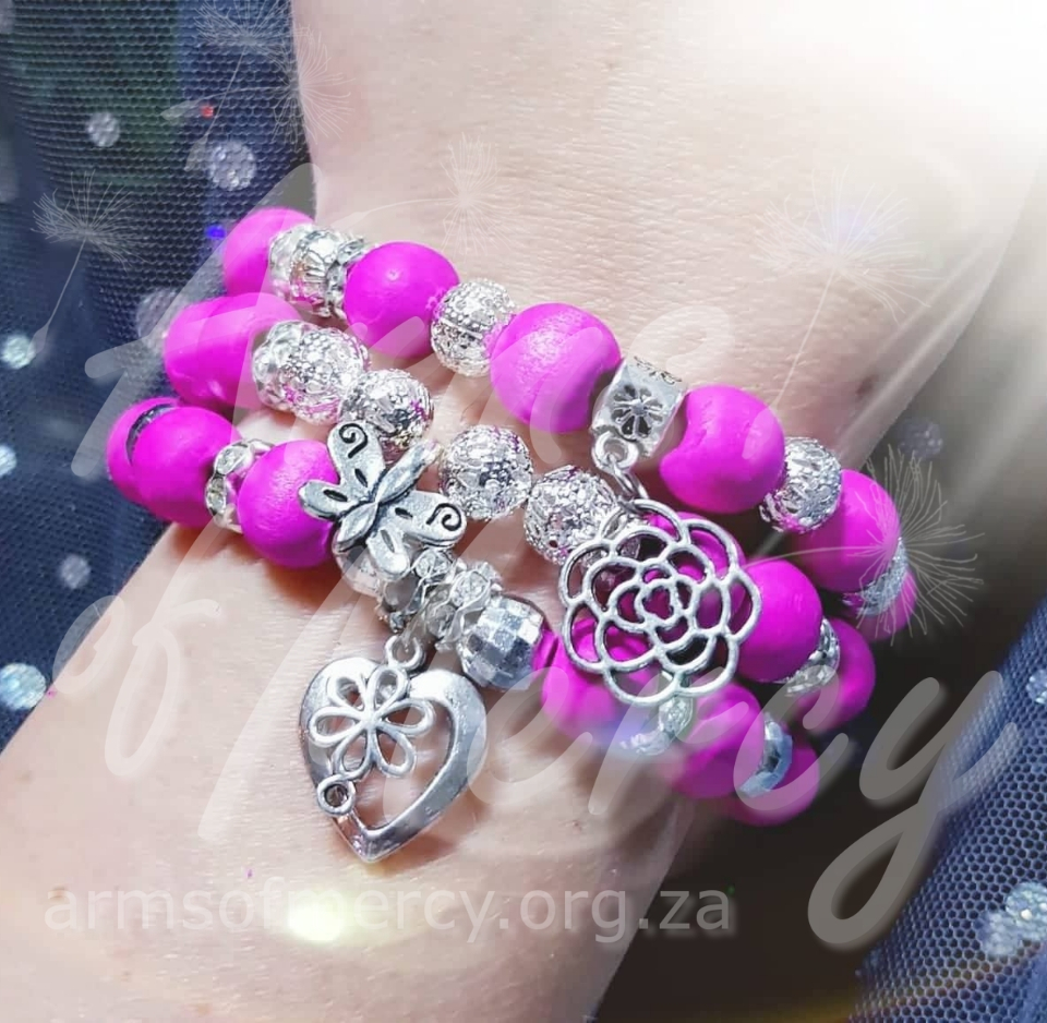 Infused with Pink Bracelets © Arms of Mercy NPC