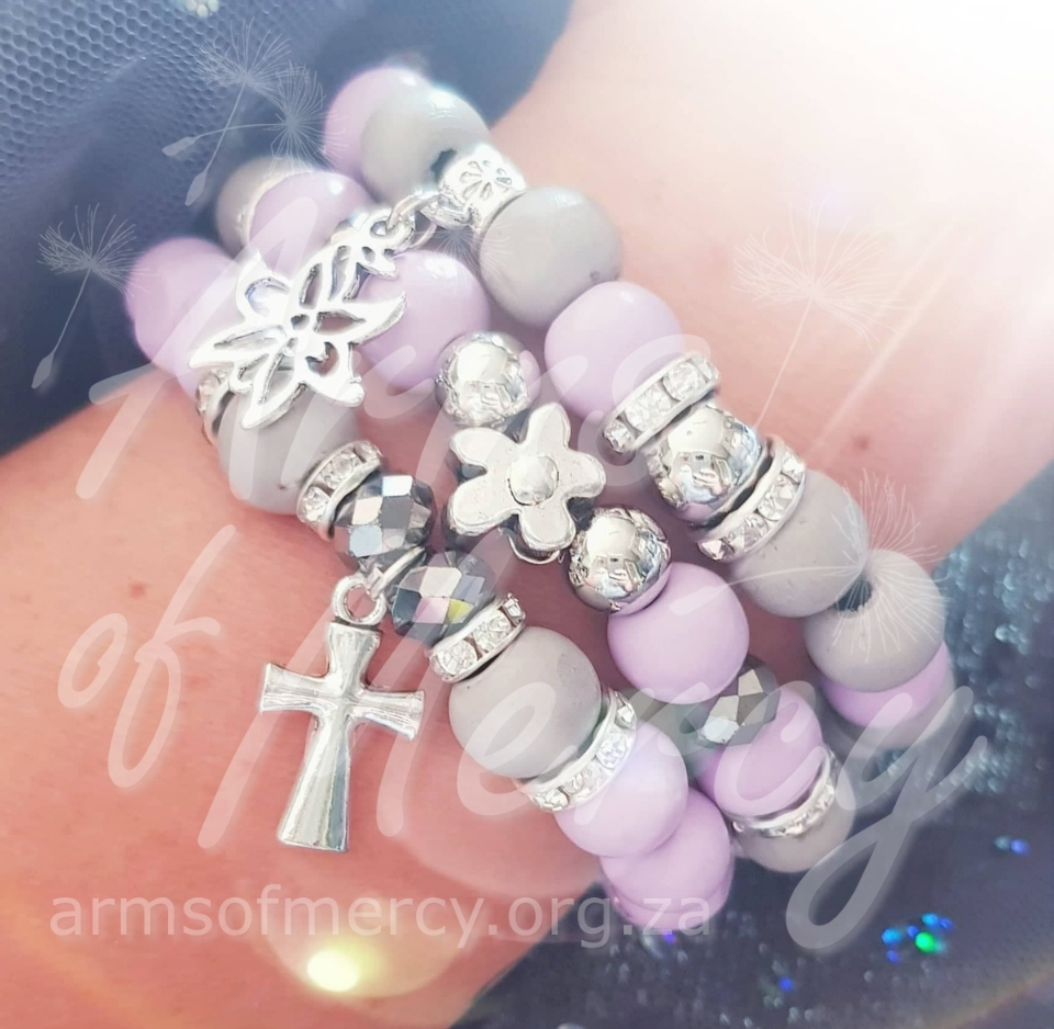 Lilac Blossom Bracelets © Arms of Mercy NPC