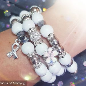 Bloom with Grace Bracelets (White) © Arms of Mercy NPC