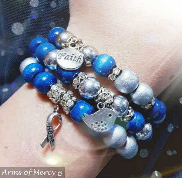 Delightful Teal Bracelets © Arms of Mercy NPC