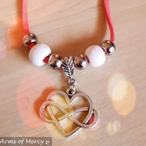 Infinity Heart Necklace © Arms of Mercy NPC