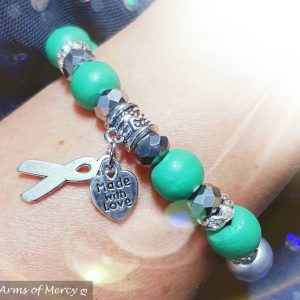 Liver Cancer Awareness Bracelet © Arms of Mercy NPC
