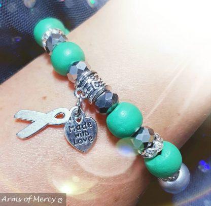 Liver Cancer Awareness Bracelet © Arms of Mercy NPC