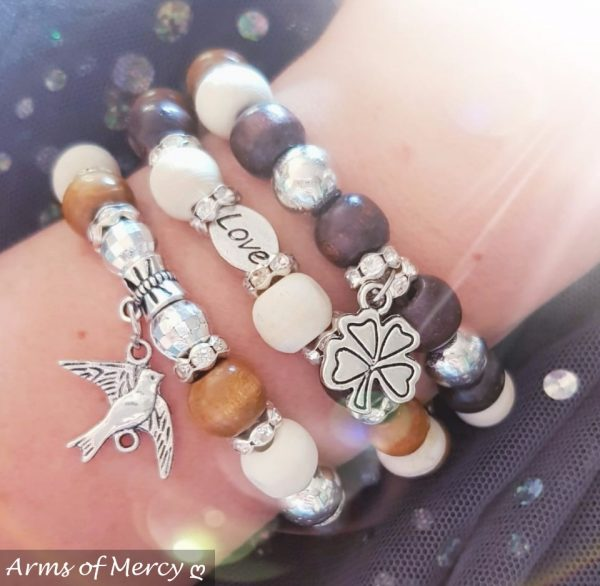 Powered by Love Bracelets © Arms of Mercy NPC