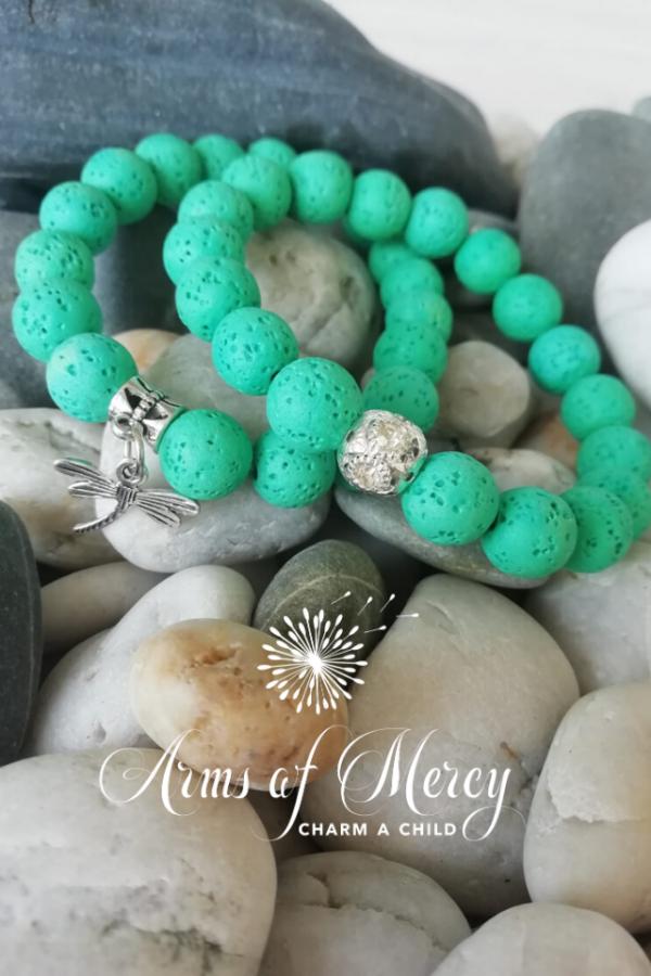 green lava beads bracelet - arms of mercy npc