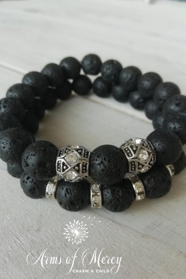 black lava beads bracelet - arms of mercy npc