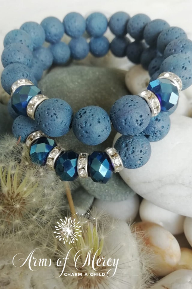 dove blue lava beads bracelet - arms of mercy npc