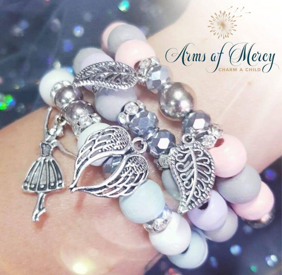 Faith Love Strength Bracelets © Arms of Mercy NPC