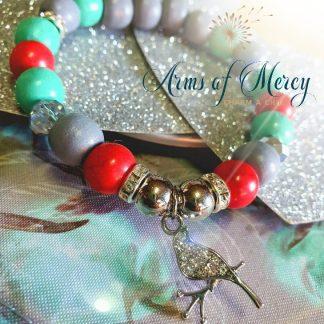 Red Marble Bead Bracelet © Arms of Mercy NPC