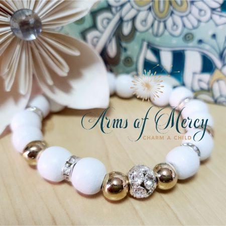 White & Gold Bead Bracelet © Arms of Mercy NPC