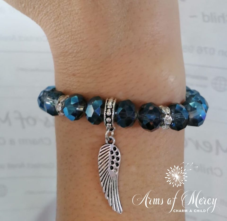Blue Crystal Beads Bracelet with Angel Wing Charm © Arms of Mercy NPC