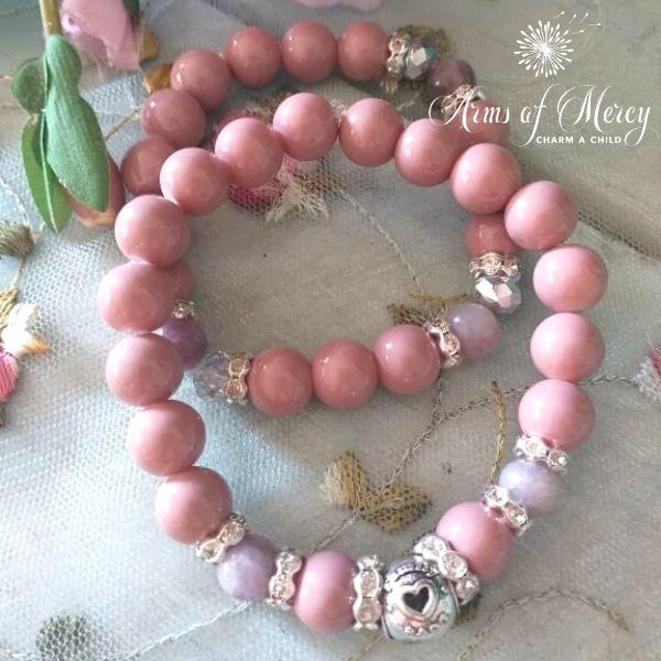 Dusty Pink Glass Beads and Jasper Bracelet Set © Arms of Mercy NPC